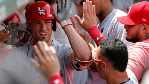 St. Louis Cardinals' Randal Grichuk celebrates his home run off Chicago Cubs starting pitcher Jake Arrieta in the dugout during the second inning of a baseball game Friday, July 21, 2017, in Chicago. (AP Photo/Charles Rex Arbogast)