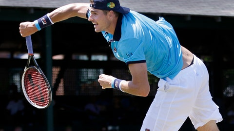 Top seed John Isner serves to Dennis Novikov in their quarterfinal match at the Hall of Fame Tennis Championships, Friday, July 21, 2017, in Newport, R.I. Isner won 6-4, 6-4. (AP Photo/Elise Amendola)