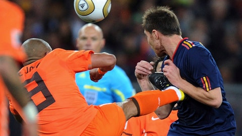 FILE - In this Sunday, July 11, 2010, file photo, Netherlands' Nigel de Jong, left, fouls Spain's Xabi Alonso during the World Cup final soccer match at Soccer City in Johannesburg, South Africa. Howard Webb says he would have given De Jong a red card in the 2010 World Cup final if a video assistant referee had been in place. The retired English referee showed De Jong a yellow card in the 28th minute for his karate kick into the chest of Alonso. (AP Photo/Daniel Ochoa de Olza, File)