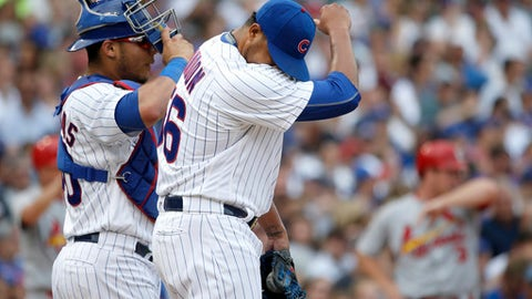 Chicago Cubs relief pitcher Hector Rondon, right, returns to the mound with Willson Contreras after Rondon walked in a run during the eighth inning of a baseball game against the St. Louis Cardinals Friday, July 21, 2017, in Chicago. (AP Photo/Charles Rex Arbogast)