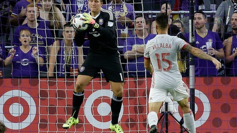 Orlando City goalkeeper Joseph Bendik, left, blocks a shot on goal as Atlanta United's Hector Villalba (15) moves in during the first half of an MLS soccer match, Friday, July 21, 2017, in Orlando, Fla. (AP Photo/John Raoux)