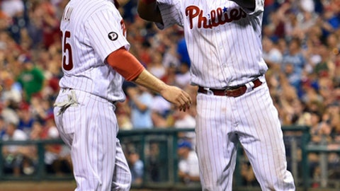 Philadelphia Phillies' Maikel Franco, right, high-fives Daniel Nava after they scored on a Tommy Joseph double off Milwaukee Brewers' Carlos Torres during the sixth inning of a baseball game, Friday, July 21, 2017, in Philadelphia. (AP Photo/Derik Hamilton)