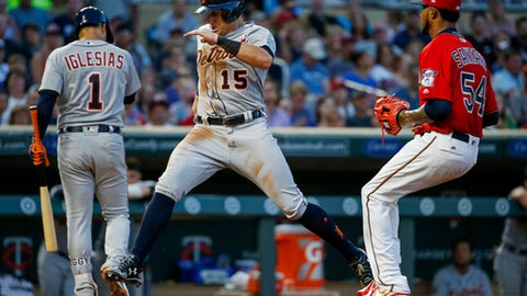 Detroit Tigers' Mikie Mahtook, center, scores ahead of Minnesota Twins starting pitcher Ervin Santana, right, on a wild pitch in the fourth inning of a baseball game Friday, July 21, 2017, in Minneapolis. (AP Photo/Bruce Kluckhohn)