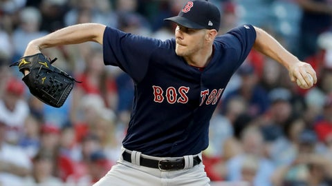 Boston Red Sox starting pitcher Chris Sale throws against the Los Angeles Angels during the first inning of a baseball game in Anaheim, Calif., Friday, July 21, 2017. (AP Photo/Chris Carlson)
