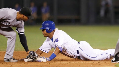 Kansas City Royals' Salvador Perez, right, is safe with a double as Chicago White Sox second baseman Yoan Moncada, left, is late with the tag during the fifth inning of a baseball game at Kauffman Stadium in Kansas City, Mo., Friday, July. 21, 2017. (AP Photo/Colin E. Braley)