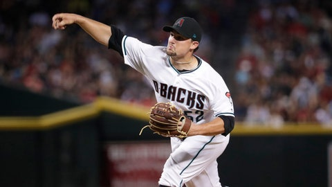 Arizona Diamondbacks starting pitcher Zack Godley throws to the Washington Nationals during the fifth inning of a baseball game, Friday, July 21, 2017, in Phoenix. (AP Photo/Matt York)