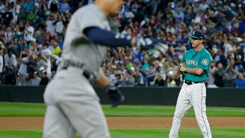 Seattle Mariners starting pitcher Andrew Moore, right, stands near the mound as New York Yankees' Aaron Judge rounds the bases after hitting a three-run home run during the fifth inning of a baseball game, Friday, July 21, 2017, in Seattle. (AP Photo/Ted S. Warren)