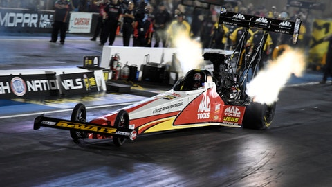 In this photo provided by the NHRA, Doug Kalitta drives in Top Fuel qualifying for the Mopar Mile-High NHRA Nationals drag races at Bandimere Speedway on Friday, July 21, 2017, in Morrison, Colo. (Jerry Foss/NHRA via AP)