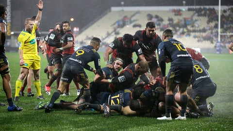 Referee Angus Gardner, left, awards a try to the Canterbury Crusaders during their Super Rugby quarterfinal against the Highlanders in Christchurch, New Zealand, Saturday, July 22, 2017. (AP Photo/Mark Baker)
