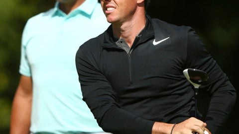 Northern Ireland's Rory McIlroy watches his shot from the 5th tee box with Gary Woodland of the United States, left, during the third round of the British Open Golf Championship, at Royal Birkdale, Southport, England, Saturday July 22, 2017. (AP Photo/Dave Thompson)