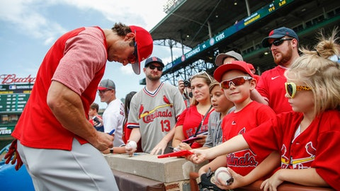 St. Louis Cardinals' Randal Grichuk signs autographs before a baseball game against the Chicago Cubs, Saturday, July 22, 2017, in Chicago. (AP Photo/Kamil Krzaczynski)