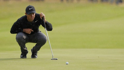 Britain's Rory McIlroy looks at his putt on the 17th green during the third round of the British Open Golf Championship, at Royal Birkdale, Southport, England, Saturday July 22, 2017. (AP Photo/Alastair Grant)