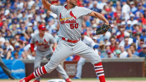 St. Louis Cardinals starting pitcher Adam Wainwright delivers against the Chicago Cubs during the first inning of a baseball game, Saturday, July 22, 2017, in Chicago. (AP Photo/Kamil Krzaczynski)