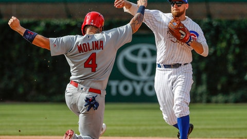 Chicago Cubs' Ben Zobrist, right, throws out St. Louis Cardinals' Yadier Molina, left, at the second base during the eight inning of a baseball game, Saturday, July 22, 2017, in Chicago. (AP Photo/Kamil Krzaczynski)