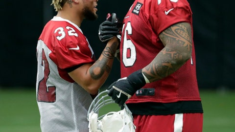 Arizona Cardinals free safety Tyrann Mathieu (32) and guard Mike Iupati (76) greet each other during the first day of NFL football training camp for the team, Saturday, July 22, 2017, in Glendale, Ariz. (AP Photo/Matt York)