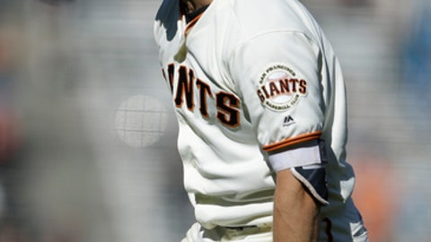 San Francisco Giants catcher Nick Hundley celebrates after making the winning hit in the twelfth inning of a baseball game against the San Diego Padres, Saturday, July 22, 2017, in San Francisco. (AP Photo/Ben Margot)