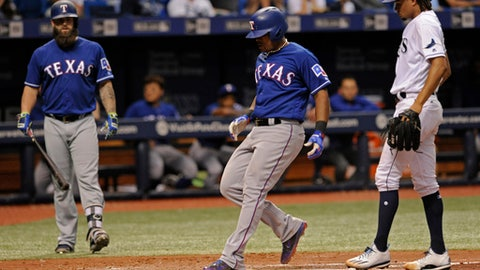 Texas Rangers' Mike Napoli, left, looks on as Adrian Beltre, center, scores from third base on a wild pitch by Tampa Bay Rays starter Chris Archer, right, during the sixth inning of a baseball game Saturday, July 22, 2017, in St. Petersburg, Fla. (AP Photo/Steve Nesius)