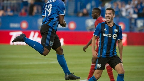 Montreal Impact's Michael Salazar celebrates his first-half goal against FC Dallas during MLS soccer game action in Montreal, Saturday, July 22, 2017. (Peter McCabe/The Canadian Press via AP)