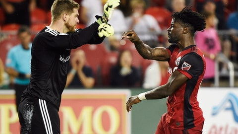 Colorado Rapids goalkeeper Zac MacMath (18) and Toronto FC forward Tosaint Ricketts (87) argue during the second half of an MLS soccer match Saturday, July 22, 2017, in Toronto. (Nathan Denette/The Canadian Press via AP)