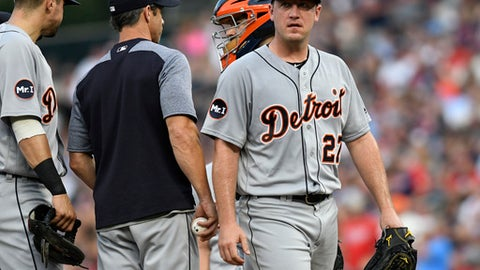 Detroit Tigers pitcher Jordan Zimmermann, right, leaves the mound after being pulled during the fourth inning of the team's baseball game against the Minnesota Twins on Saturday, July 22, 2017, in Minneapolis. (AP Photo/Tom Olmscheid)