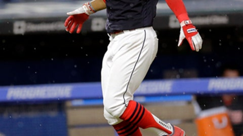 Cleveland Indians' Francisco Lindor celebrates as he runs the bases after hitting a solo home run off Toronto Blue Jays relief pitcher Danny Barnes in the 10th inning of a baseball game, Saturday, July 22, 2017, in Cleveland. (AP Photo/Tony Dejak)