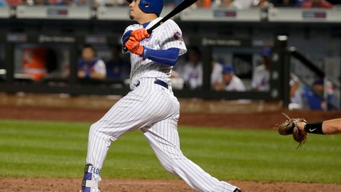 New York Mets' Wilmer Flores (4) follows through on a walkoff home run during the ninth inning of a baseball game to defeat the Oakland Athletics, Saturday, July 22, 2017, in New York. (AP Photo/Julie Jacobson)