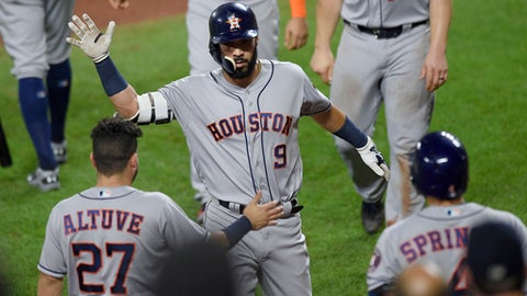 Houston Astros' Marwin Gonzalez (9) celebrates his three-run home run with Jose Altuve (27) and George Springer (4) during the sixth inning of a baseball game against the Baltimore Orioles, Saturday, July 22, 2017, in Baltimore. (AP Photo/Nick Wass)