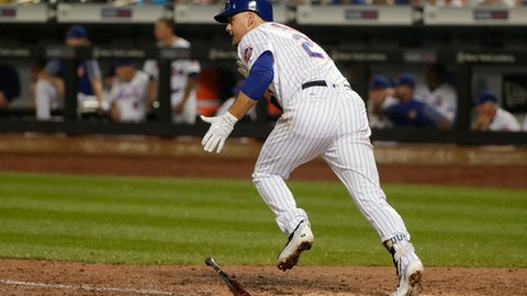 New York Mets ' Lucas Duda (21) heads down the first base line on a base hit to drive in the tying run against the Oakland Athletics during the eighth inning of a baseball game, Saturday, July 22, 2017, in New York. (AP Photo/Julie Jacobson)