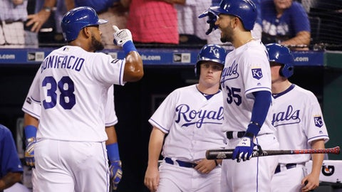 Kansas City Royals' Jorge Bonifacio (38) celebrates his solo home run with Eric Hosmer (35) during the seventh inning of the team's baseball game against the Chicago White Sox at Kauffman Stadium in Kansas City, Mo., Saturday, July 22, 2017. The Royals defeated the White Sox 7-2. (AP Photo/Colin E. Braley)
