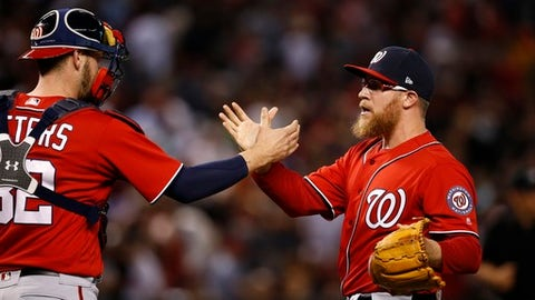 Washington Nationals' Sean Doolittle, right, celebrates the final out against the Arizona Diamondbacks with catcher Matt Wieters, left, during the ninth inning of a baseball game Saturday, July 22, 2017, in Phoenix. (AP Photo/Ross D. Franklin)