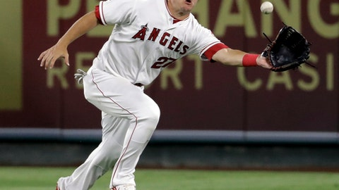 Los Angeles Angels center fielder Mike Trout catches a fly ball hit by Boston Red Sox's Christian Vazquez during the sixth inning of a baseball game in Anaheim, Calif., Saturday, July 22, 2017. (AP Photo/Chris Carlson)