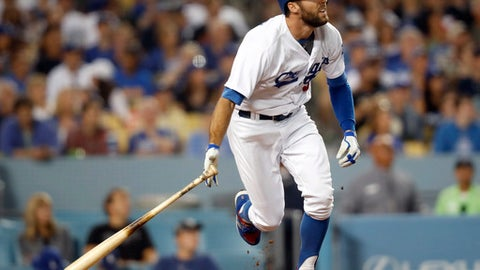 Los Angeles Dodgers' Chris Taylor watches his solo home run off Atlanta Braves starting pitcher Julio Teheran during the seventh inning of a baseball game, Saturday, July 22, 2017, in Los Angeles. (AP Photo/Ryan Kang)