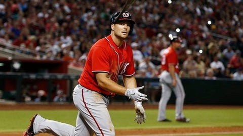Washington Nationals' Chris Heisey tosses his bat after earning a walk against the Arizona Diamondbacks during the seventh inning of a baseball game Saturday, July 22, 2017, in Phoenix. (AP Photo/Ross D. Franklin)