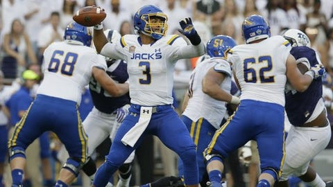 South Dakota State quarterback Taryn Christion (3) passes as linemen Charlie Harmon (68) and Jacob Ohnesorge (62) block TCU defenders during the first half of an NCAA college football game Saturday, Sept. 3, 2016, in Fort Worth, Texas. (AP Photo/LM Otero)
