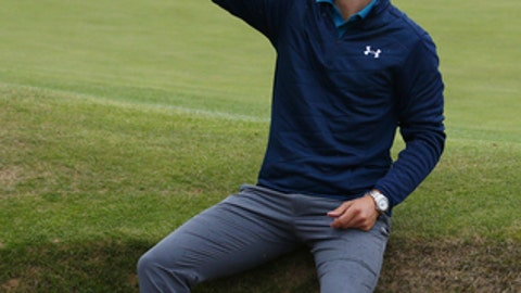 Jordan Spieth of the United States holds the trophy after winning the British Open Golf Championships at Royal Birkdale, Southport, England, Sunday July 23, 2017. (AP Photo/Dave Thompson)