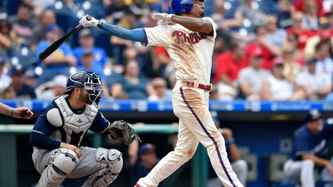 Philadelphia Phillies' Nick Williams, right, watches his two-run home run off Milwaukee Brewers' Junior Guerra during the fourth inning of a baseball game, Sunday, July 23, 2017, in Philadelphia. (AP Photo/Derik Hamilton)