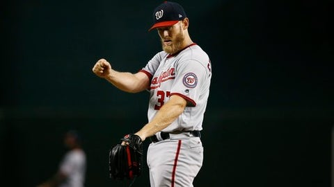 Washington Nationals' Stephen Strasburg warms up during the first inning of a baseball game against the Arizona Diamondbacks, Sunday, July 23, 2017, in Phoenix.  (AP Photo/Ross D. Franklin)