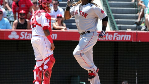 Boston Red Sox' Hanley Ramirez passes Los Angeles Angels catcher Martin Maldonado on a solo home run in the sixth inning of a baseball game in Anaheim, Calif., Sunday, July 23, 2017. (AP Photo/Reed Saxon)