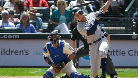 New York Yankees' Aaron Judge strikes out swinging as Seattle Mariners catcher Carlos Ruiz and home plate umpire Tom Woodring look on in the fifth inning of a baseball game, Sunday, July 23, 2017, in Seattle. (AP Photo/Ted S. Warren)