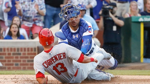 Chicago Cubs' Willson Contreras, right, tags out St. Louis Cardinals' Matt Carpenter, left, during the first inning of a baseball game, Sunday, July 23, 2017, in Chicago. (AP Photo/Kamil Krzaczynski)