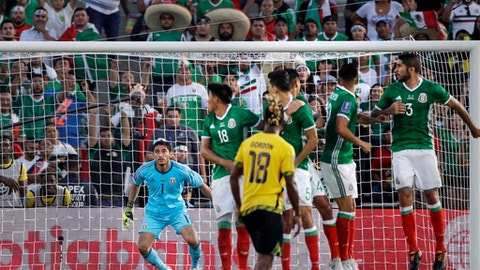 Mexico Goalkeeper Jesus Corona, left, watches a goal scored by Jamaica's Kemar Lawrence during the second half of a CONCACAF Gold Cup semifinal soccer match in Pasadena, Calif., Sunday, July 23, 2017. (AP Photo/Jae Hong)