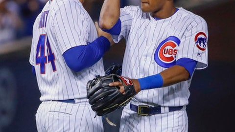 Chicago Cubs' Anthony Rizzo, left, celebrates with Addison Russell, right, after the Cubs defeated the St. Louis Cardinals 5-3 in a baseball game, Sunday, July 23, 2017, in Chicago. (AP Photo/Kamil Krzaczynski)