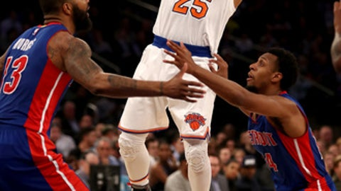 NEW YORK, NY - MARCH 27:  Derrick Rose #25 of the New York Knicks passes the ball as Marcus Morris #13 and Ish Smith #14 of the Detroit Pistons defend  at Madison Square Garden on March 27, 2017 in New York City. NOTE TO USER: User expressly acknowledges and agrees that, by downloading and or using this Photograph, user is consenting to the terms and conditions of the Getty Images License Agreement  (Photo by Elsa/Getty Images)