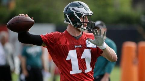 Philadelphia Eagles quarterback Carson Wentz throws a pass during an NFL football training camp in Philadelphia, Monday, July 24, 2017. (AP Photo/Matt Rourke)