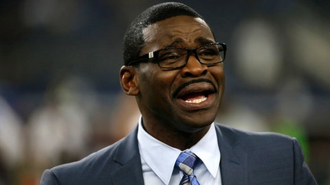 FILE - In this Sept. 1, 2016, file photo, broadcast personality and former Dallas Cowboys player Michael Irvin talks with people on the field before a preseason NFL football game between the Cowboys and Houston Texans, in Arlington, Texas. Prosecutors say there's insufficient evidence to file sexual assault charges against Michael Irvin, a former football star for the Dallas Cowboys and the University of Miami. A 27-year-old woman accused Irvin of drugging and sexually assaulting her at the W Hotel in Fort Lauderdale in March. (AP Photo/Ron Jenkins, File)