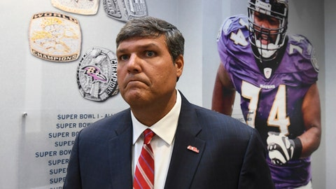 Mississippi NCAA college football interim head coach Matt Luke walks into a press conference in Oxford, Miss. on Monday, July 24, 2017. (Bruce Newman, Oxford Eagle via AP)