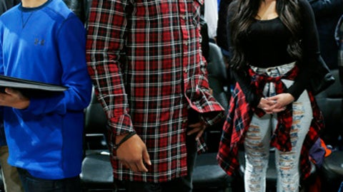 FILE - In this Wednesday, Jan. 13, 2016, file photo, Denver Broncos safety David Bruton looks on during the second half of an NBA basketball game between the Golden State Warriors and Denver Nuggets in Denver. Bruton announced that he will retire from football, Monday, July 24, 2017. (AP Photo/David Zalubowski, File)