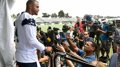 Dallas Cowboys quarterback Dak Prescott speaks during a media conference following practice at the NFL football team's training camp in Oxnard, Calif., Monday, July 24, 2017. (AP Photo/Michael Owen Baker)