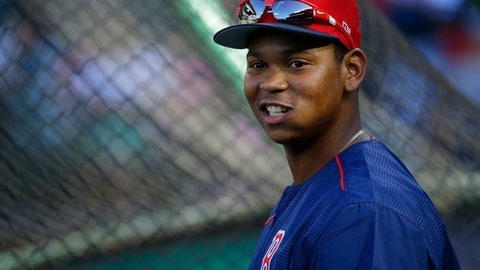 Boston Red Sox third baseman Rafael Devers stands near the cage during batting practice before a baseball game against the Seattle Mariners, Monday, July 24, 2017, in Seattle. (AP Photo/Ted S. Warren)