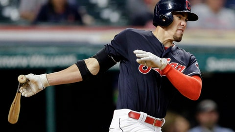 Cleveland Indians' Bradley Zimmer hits an RBI-single off Cincinnati Reds relief pitcher Blake Wood in the seventh inning of a baseball game, Monday, July 24, 2017, in Cleveland. Giovanny Urshela scored on the play. (AP Photo/Tony Dejak)